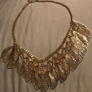 Gold colored feather necklace